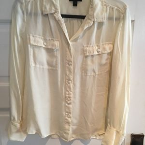 Cream colored women's long sleeved silk blouse
